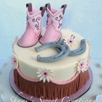 Sweet Baby Shower Cake With Baby Cowboy Boots Horseshoes And Western Fringe Sweet Baby shower cake with baby cowboy boots, horseshoes and western fringe.