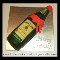 Jameson Whiskey Bottle Sponge cake with a vsanilla caramel buttercream center :).....please check out my other photos :)