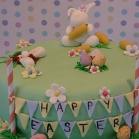 "Easter Bunny And Bunting. This is a simnel cake we made for a charity raffle. The bunny was inspired by weelovetobake blog .. although ours came out ""chubbier&..."