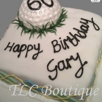 Golf Birthday Cake This is a birthday cake for my next door neighbour who is mad on golf, I made a fondant golf ball and hand rolled every blade of grass from...