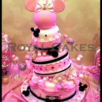 Minnie!   Beautiful three tier whimsical pink Minnie Mouse cake!