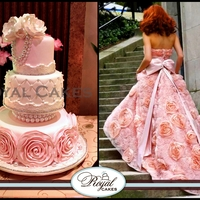 Confection Couture!   Hand crafted sugar rosettes and accents of pearls complement fashion at its best!