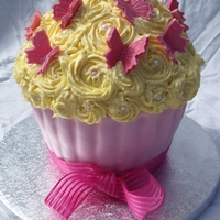 Giant Cupcake Cake Giant vanilla cupcake cake with lemon buttercream and a chocolate buttercream filling (as requested). Base is covered with pink fondent and...
