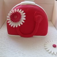 Handbag Cake I made this cake for my mother-in- law and then had request to make one for a lady who had seen the cake and offered to pay....my first...