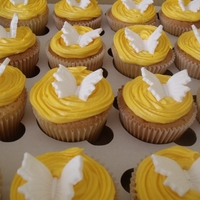 Lemon Cupcakes Lemon cupcakes with lemon cream cheese frosting and fondent butterfly