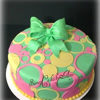 Pastel Circle Birthday Cake A swirl of Pastel Circles of different sizes cover the cake. Cake is a Lemon Chiffon cake with Raspberry Filling and white chocolate...