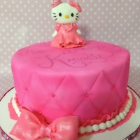 Hello Kitty Birthday Cake   Hello Kitty with pillow top style cake, pearls all around. Bow and Hello Kitty made from gumpaste.