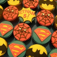 Superhero Cupcakes MMF on buttercream. All decorations made by hand, Superman and Batman were done using paper templates.