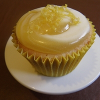 Triple Lemon Cupcake Lemon sponge with a swirl of lemon cream cheese frosting and lemon curd.