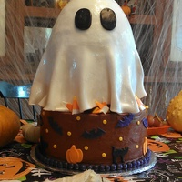 "Chocolate 10 Round With 8 Round Stacked And Rice Crispy Treat Top To Create The Ghosts Head And Upper Body   Chocolate 10' round with 8"" round stacked and rice crispy treat top to create the ghosts head and upper body."