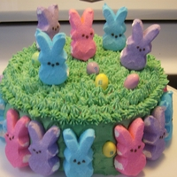 Peeps Cake Easter cake with green grass, Peeps and Peanut M&M's as eggs.