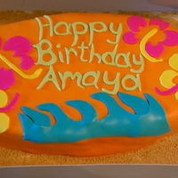 Surfboard Cake My first marshmallow fondant covered cake.Hawiian themed cake. Half of the cake is chocolate, the other half strawberry.