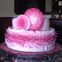 "Pink Ruffle Cake Two tier 8"" and 6"" vanilla cake covered in fondant ruffles."