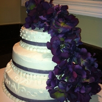 Purple Cascade I made this cake for a bridal shower. I used purple ribbon and silk flowers for this cake. Frosted entirely in buttercream. 10, 8, and 6...