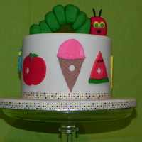 The Very Hungry Caterpillar Baby shower cake based on the childrens book The Very Hungry Caterpillar.
