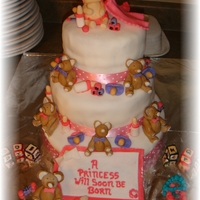 Baby Shower Cake Three tier cake filled with everything baby all made from fondant