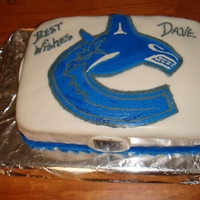 Vancouver Canucks Cake I made this cake for my friends 49th birthday he is a big Canucks fan. Logo was so easy. I printed off the logo doing it mirror image laid...