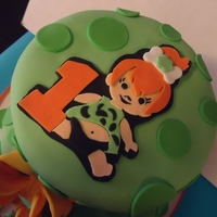Pebbles Flintstone Birthday Cake   I wanted to try the handcut fondant characters and I loved how she turned out. Time to practice adding details!
