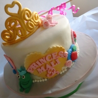 "Not So Disney Princess Cake  8"" Princess cake with the concept of Disney Princesses represented by their notable symbols. I included a seashell for Ariel, a red..."