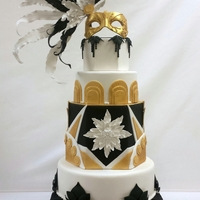 """art Deco Affair"" I made this cake for the Rocky Mountain Sugar Art Show. I pleated the fondant on the bottom tier, and used both gum paste and fondant to..."