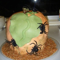 Halloween Pumpkin Cake I made this using a giant cupcake cake tin. A chocolate cake covered with butter cream and then with fondant. This is was my first attempt...