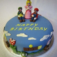 Super Mario Birthday Cake Birthday cake to a friend. Decorations made in marzipan
