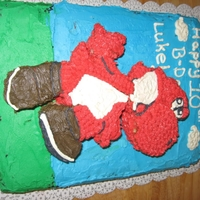 Red Yoshi Cake I cut the shape of Yoshi out of a sheet cake and put that ontop of another sheet cake to give it a bit of a 3d feel