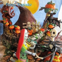 "Jack & Sally ""the Nightmare Before Christmas"" I Modelled the mountain using RKT( Rice Krispy treat )All the figurines are hand modelled with Modelling paste.The Large Pumping Is a..."