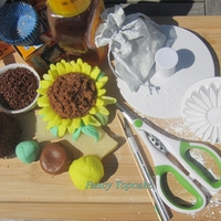 Sunflower Cupcake This cup cake must be baked in a mini cupcake size,sugar syrup or honey has been used as an edible glue,use Flower paste and larg size of...