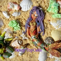 Mermaid Mermaid and speckled crab made of modelling paste on the edible sand and seashell.