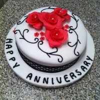 Anniversary Cake Just finished this cake for a friend, my first attempt at roses, don't think they turned out too bad, really enjoyed doing it!