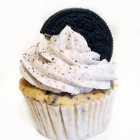 Oreo Cupcake Vanilla Oreo Cupcake - with a Secret Oreo inside, filled with Chocolate Sauce, with an Oreo Frosting and a crushed Oreo topping