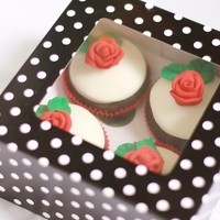 "Red Roses Gift Box These cupcakes are covered in Basic Fondant with red roses made of Basic Gumpaste. Both recipes are taken from a ebook called ""Icing..."
