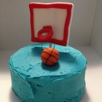 "Basketball Cake Just a small 4"" cake I made for my neighbors son who loves basketball."