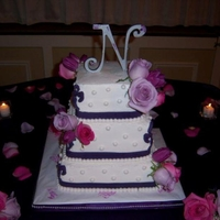 Purple Rose 3 tier square butter cram icing with real flowers and fondant details