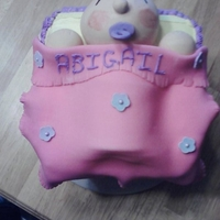 It's A Girl Block baby girl on top of giant block. baby and blanket made of fondant letters made of gum paste