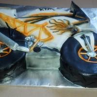 "Ktm Chocolate Cake Covered In Fondant And Airbrushed The Wheels Are 8 Cakes For Size Comparison KTM Chocolate cake covered in fondant and airbrushed. The wheels are 8"" cakes for size comparison."