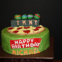 Teenage Muntant Ninja Turtle Cake This Is Two Ten Inch Chocolate With A Small Cake On Top Cut In Half And Stacked Pepperoni Pizza And Turt... Teenage Muntant Ninja Turtle cake. This is two ten inch chocolate with a small cake on top cut in half and stacked. Pepperoni Pizza and...