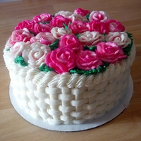 Basket Of Roses Vanilla bean cake with raspberry curd filling and American butter cream icing and roses.