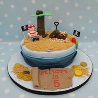 "Pirate Cake 9"" Vanilla cake. Fun to make, apart from the waves!! Also came downstairs the next morning to find the leaves had fallen off the palm..."