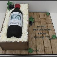 Wine Bottle Retirement Cake  My first 'bottle' cake. Lots of layers of vanilla sponge cake to build the crate. Loved making this as it turned out exactly as I...
