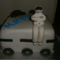 Stig From Top Gear !   fondant covered sponge cake with fondant STIG and Fondant tires & road markings.