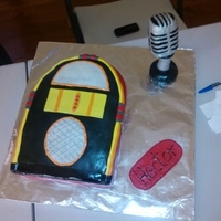 Jukebox Cake Two friends and I made this cake for a friend. The microphone is made of RKT covered in fondant and the juekebox is cake.