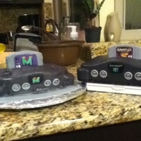 Nintendo Two friends and I made this cake using fondant. The cassette is made of RKT covered in fondant