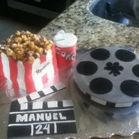 Popcorn, Movies And More   This is a cake i made with my friend for her borther's birthday. He loves movies so we made him this.
