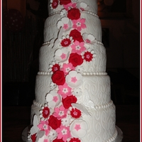 Pearl White Wedding Cake   5-Tier Pearl White Wedding Cake with al lot of Red and Pink Flowers