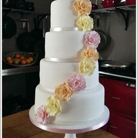 White Wedding Cake With Large Roses White Wedding Cake with Large Pastel Roses