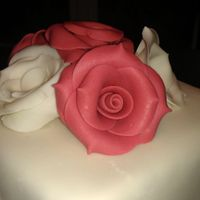 Black And White Scroll With Red Fondant Roses