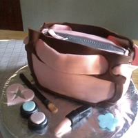 Purse Cake Purse cake I made for my aunt. My first all fondant cake!! Inside is zebra cake mix, everything us ediable!