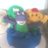 Barney And Friends My second cake! First time sculpting characters!! Not as hard as I thought. This was so fun to do! They are jumping out of cake top! Lol